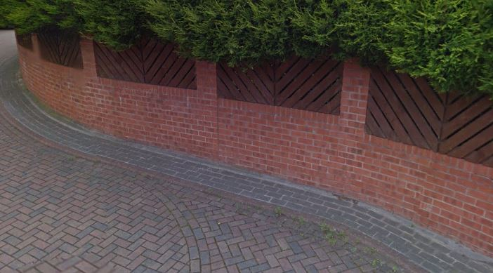 Brick Boundary Wall With Piers And Timber Panels