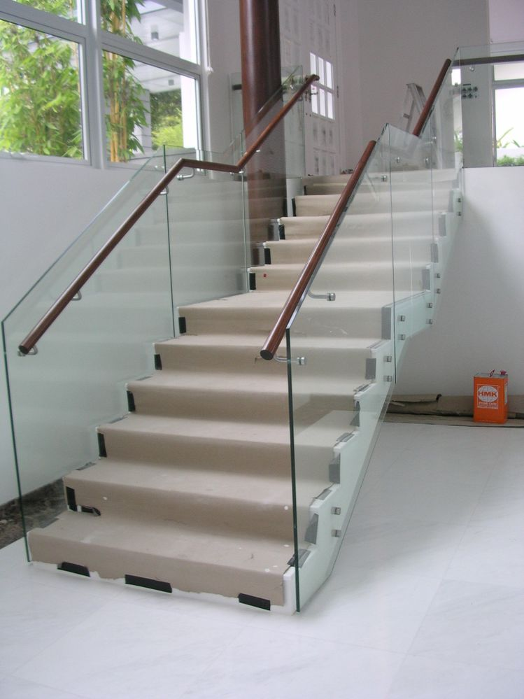 Solved glass panel railing at stair landing 2017 for Stair and railing solution